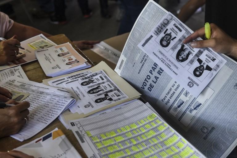 Presidente colombiano invita a ciudadanos a votar sin presión y en paz
