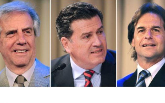 Los candidatos Tabaré Vásquez (i), Pedro Bordaberry y Luis Lacalle. Foto: AFP / Miguel Rojo