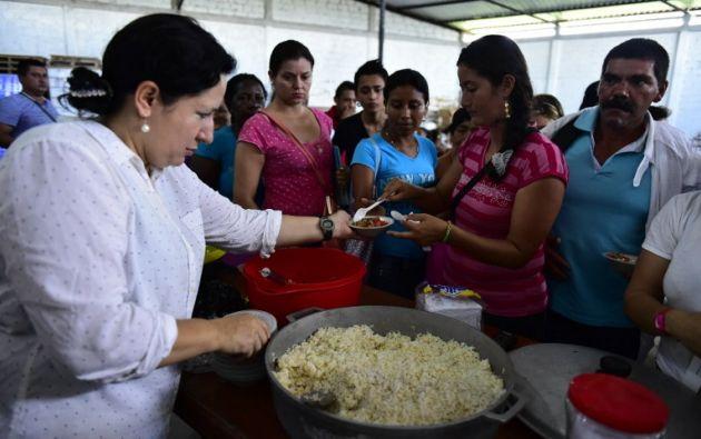 El PMA da un bono electrónico de 20 dólares para comprar alimentos. Foto: AFP / Rodrigo Buendia