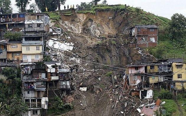 Juan Manuel Santos dijo que las lluvias de las últimas horas en Manizales no tenían precedente.  Foto: AFP