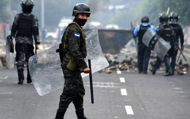 El Gobierno de Honduras denunció que Venezuela y FARC estarían financiando las manifestaciones violentas. Foto: AFP