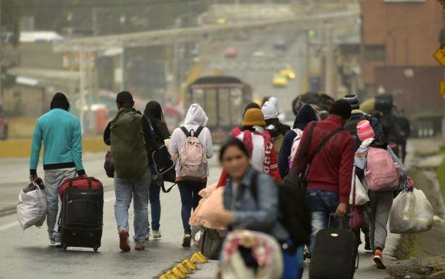 """El Plan """"Vuelta a la Patria"""" ha trasladado hasta ahora a 1.800 personas desde Ecuador. Foto: AFP"""