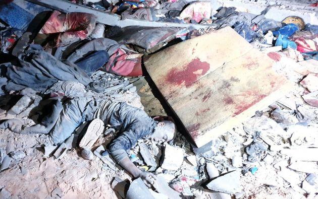 La noche del martes, al menos 44 migrantes murieron y un centenar resultaron heridos en un bombardeo contra un centro de detención en Tajura. Foto: AFP.
