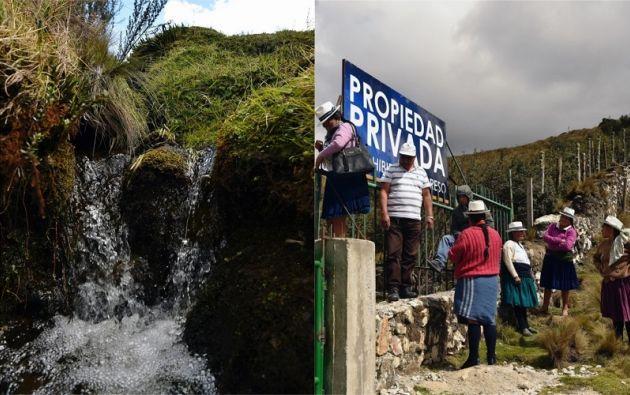 """Indígenas y activistas ambientales cruzan una cerca con un cartel colocado por una empresa minera que dice """"Propiedad privada, traspaso prohibido"""" en Quimsacocha, provincia de Azuay. Fotos: AFP"""