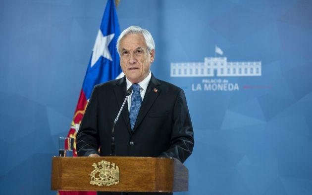 """""""Todos hemos cambiado. Con unidad y ayuda de Dios, recorreremos el camino a ese Chile mejor para todos"""", dijo Piñera. Foto: AFP"""