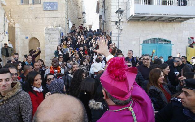 En un ambiente tranquilo y festivo, palestinos y extranjeros han ido llenando el centro de Belén. Foto: AFP.