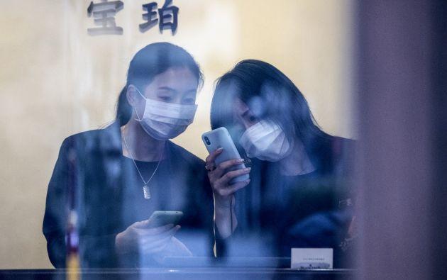 En Shangái se hizo obligatoria la utilización de mascarillas. Foto: AFP.