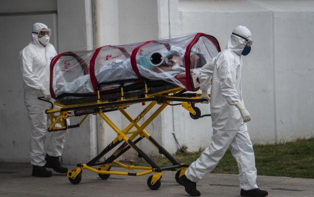 La Organización mundial de la salud (OMS) recordó el miércoles que la pandemia está lejos de ser controlada, con 106.000 nuevos casos registrados en 24 horas. Foto: AFP