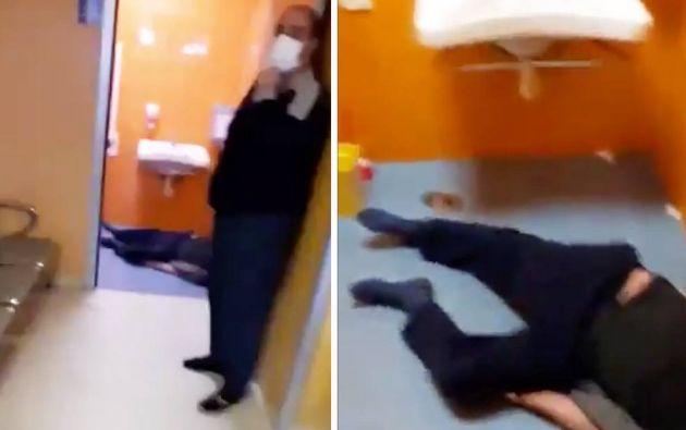 Un hombre yace aparentemente muerto en el baño de un hospital en Nápoles (Italia).