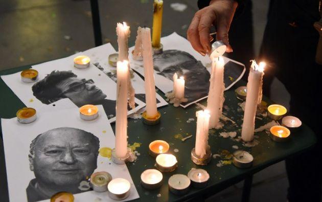 En honor a los reconocidos dibujantes del semanario. Foto: AFP
