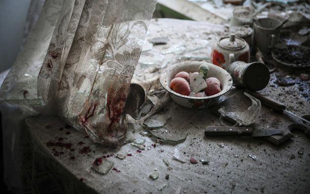 El fotógrafo ruso Sergei Ilnitsky ganó en la categoría de noticias generales. Su trabajo fotográfico muestra los daños en la mesa de una cocina en el centro de Donetsk (Ucrania), tras ser alcanzada por el fuego de artillería durante los enfrentamientos entre soldados ucranios y milicias prorrusas. Foto: World Press Photo vía REUTERS