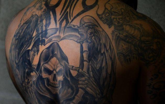 Un hombre posa durante la Convención del tatuaje Paraíso en el Centro de Convenciones de Pedregal en San Antonio de Belén , unos 20 kilómetros al oeste de San José, Costa Rica .AFP /Ezequiel BECERRA.