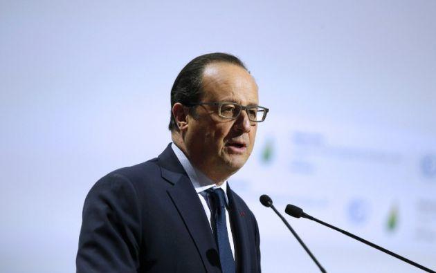 El presidente francés, Francois Hollande, pronuncia un discurso durante la sesión inaugural de la Naciones Unidas para la COP 21. AFP