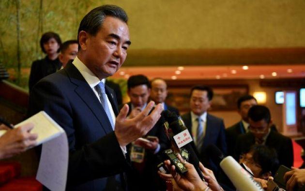 El ministro chino de Relaciones Exteriores, Wang Yi dijo que China aplicará la nueva resolución al 100%, plenamente y de forma estricta. Foto: AFP