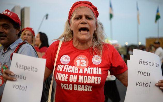 En Río de Janeiro, simpatizantes del Partido de los Trabajadores (PT) protagonizaron un altercado con opositores al Gobierno que no tuvo consecuencias. ×  4 / 10