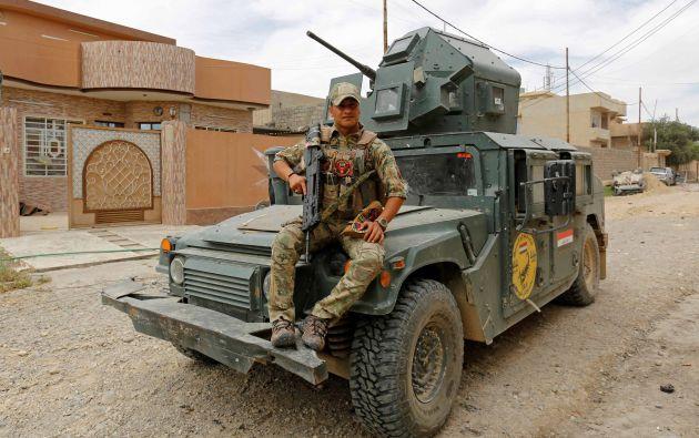 """Ali Bassem, 26, un miembro de la fuerza División de Respuesta de Emergencia Iraquí.  """"Es un héroe, es de cooperación con el pueblo iraquí y nosotros y los americanos son una nación, somos hermanos"""""""