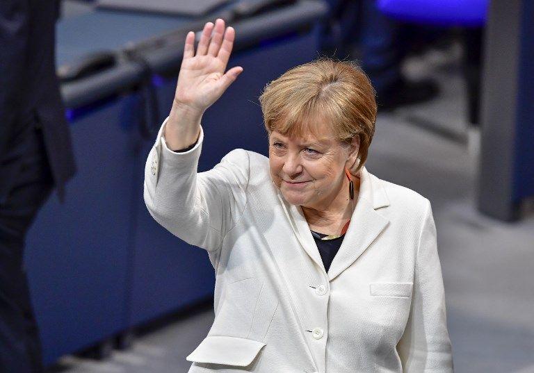 Tras casi seis meses de bloqueo político en Berlín, Merkel encarrila de esta forma su cuarta legislatura consecutiva. Foto: AFP